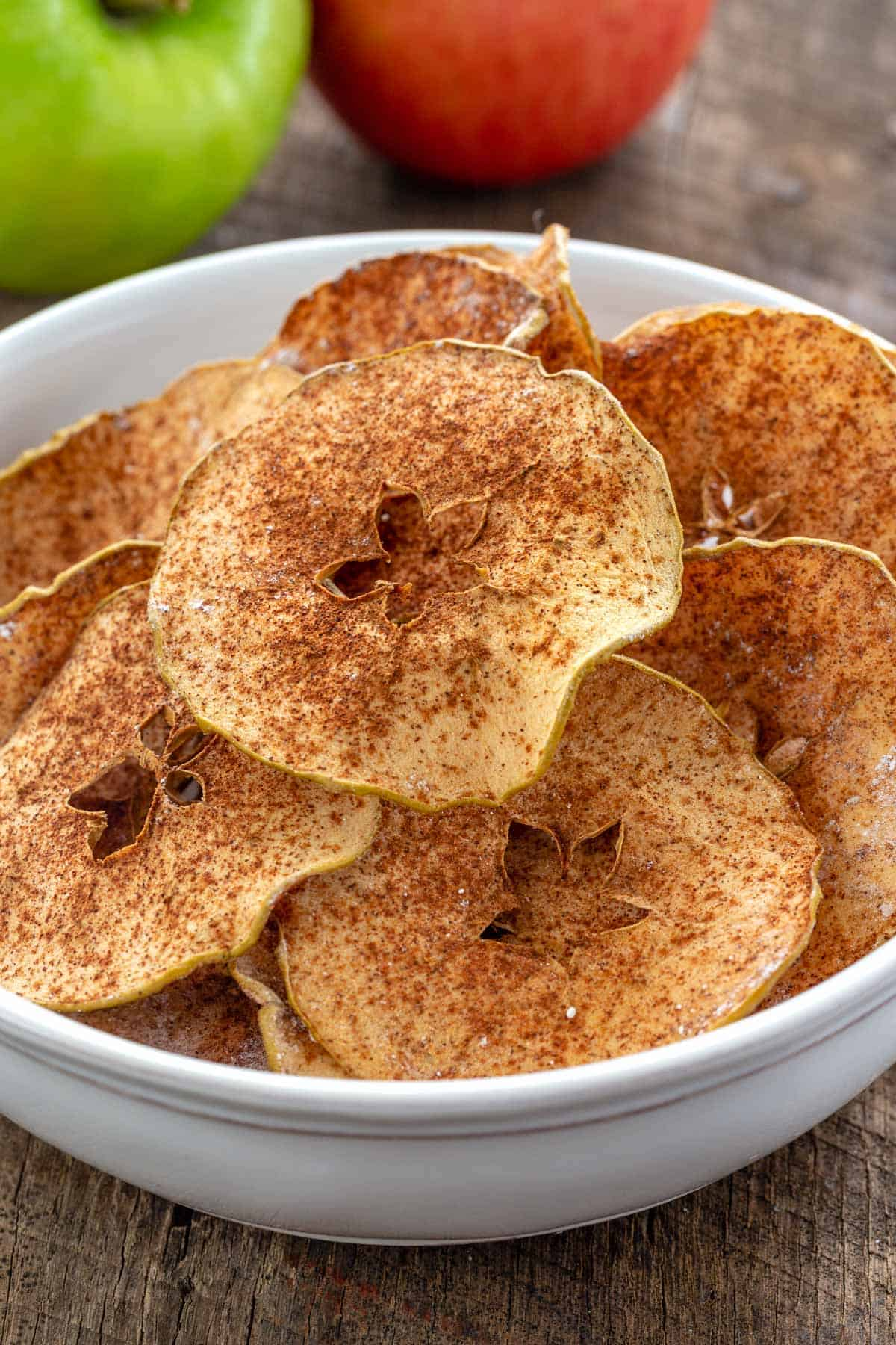 white bowl with baked apple chips