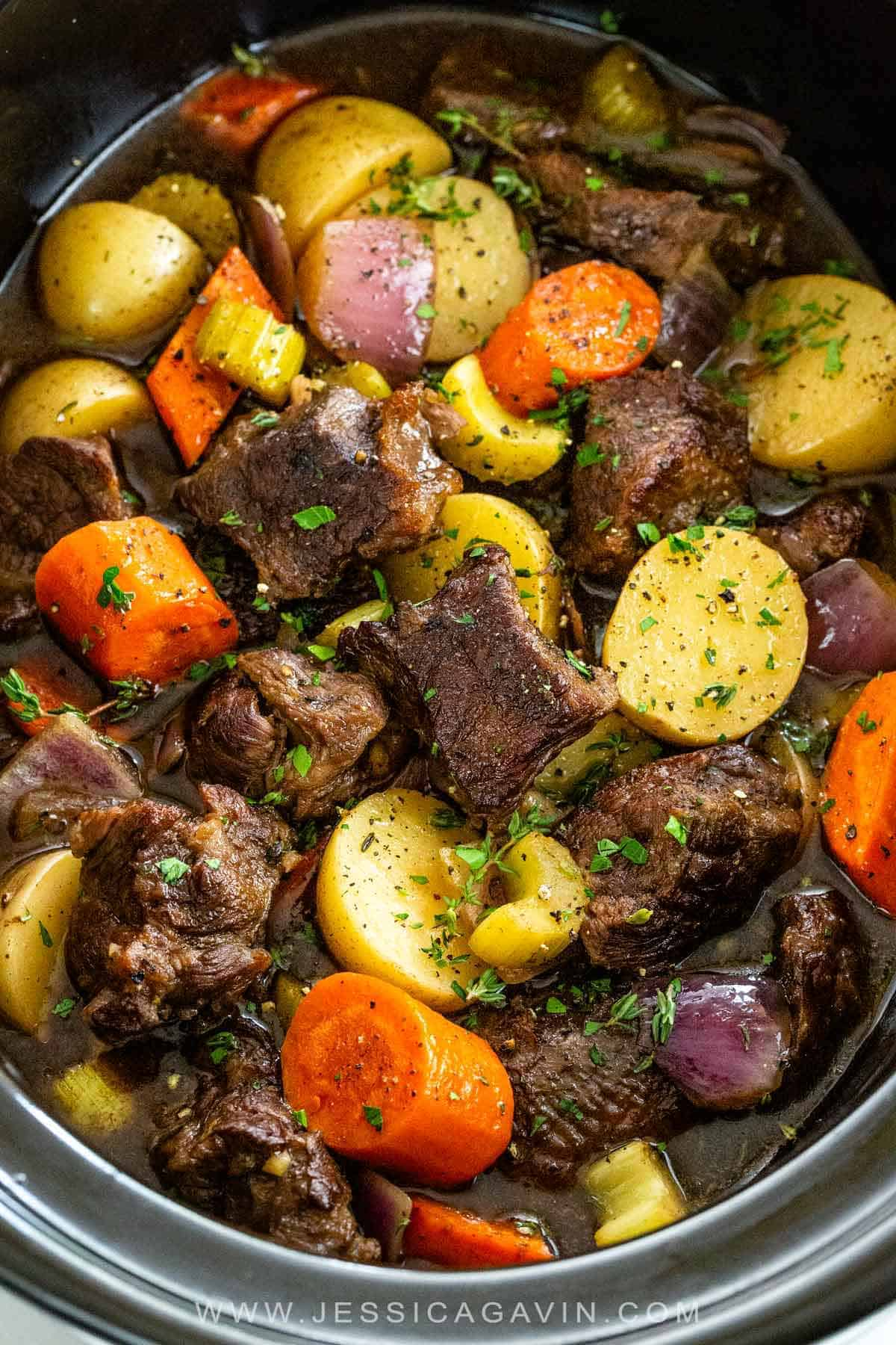 Get ready for a hearty bowl of slow cooker beef stew made with potatoes, onions, celery, carrots, and seared beef for extra flavor. #beefstew #slowcooker #crockpot