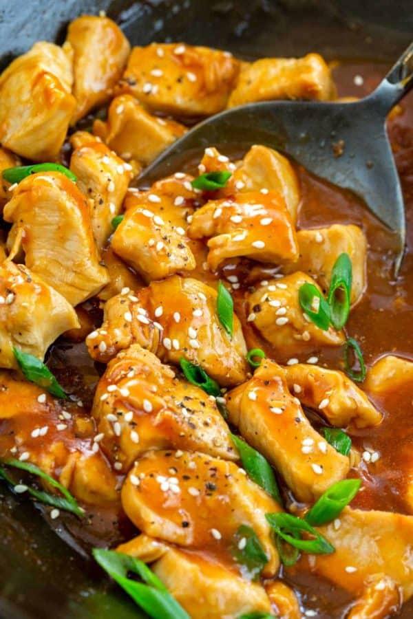 bourbon chicken cooking in a wok