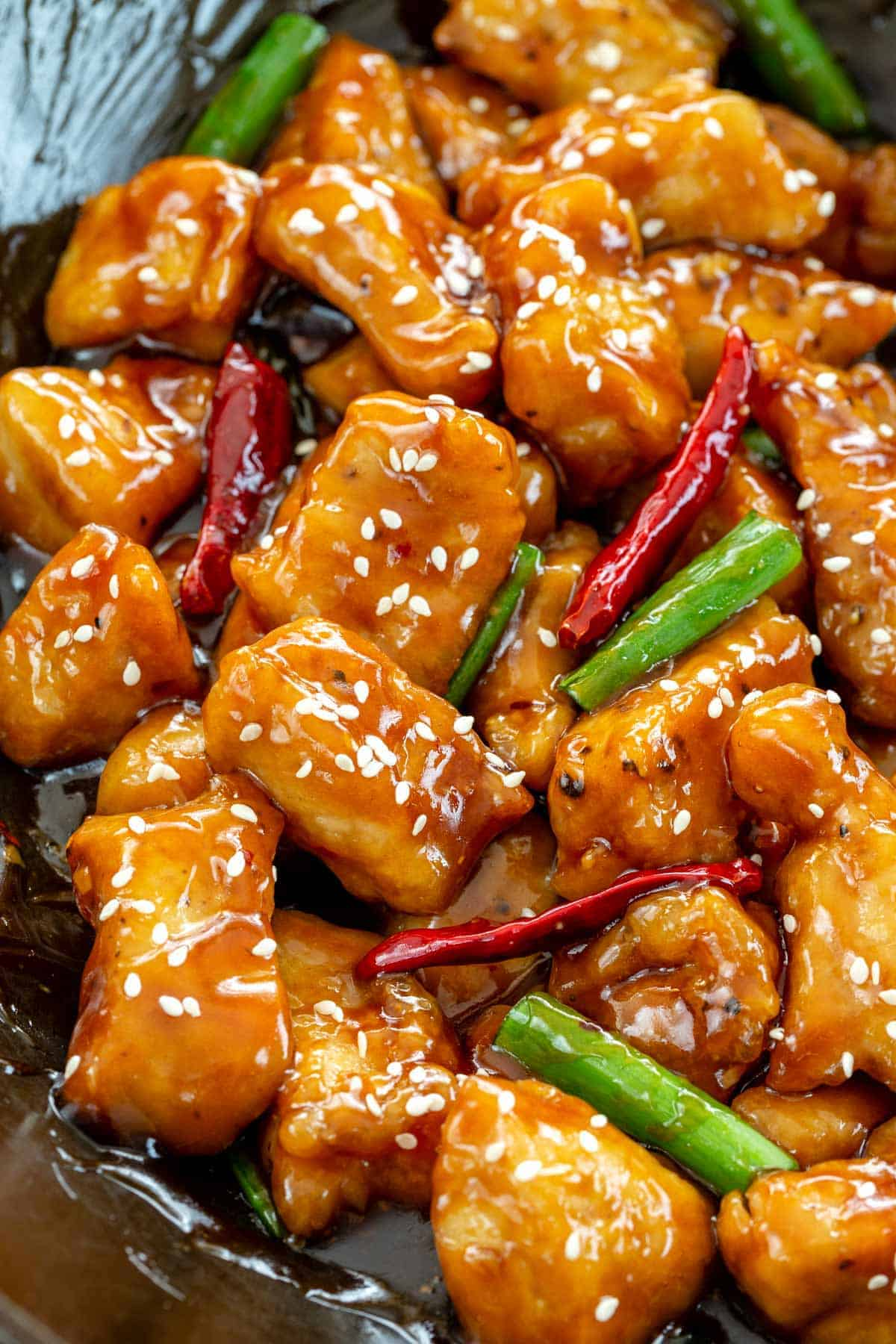 General Tso's chicken cooking in a wok