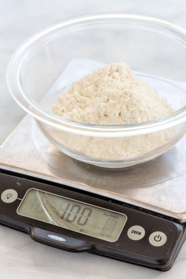 Measuring flour on a digital kitchen scale