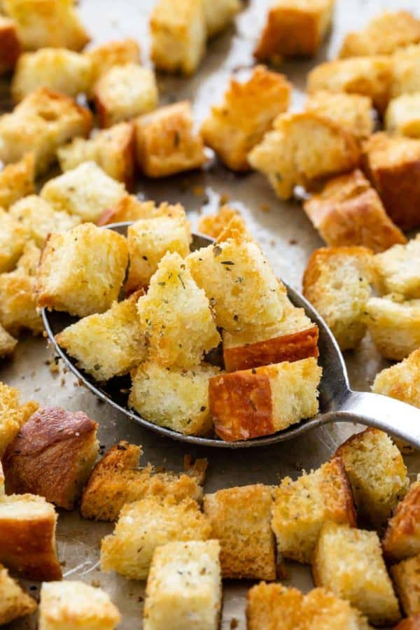 baked golden brown croutons on a sheet pan