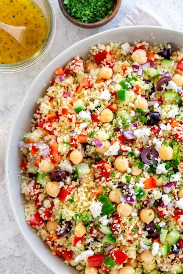 Top down photo of a mediterranean couscous salad