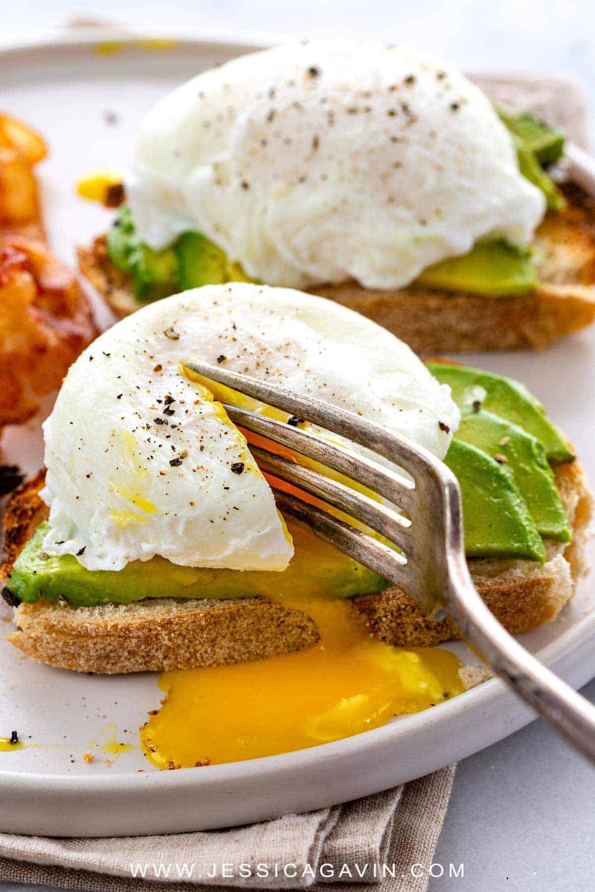 Poached eggs is a culinary technique to master that yields tender egg whites encased around a gooey golden yolk. Perfect for breakfast or to enhance a meal. #poachedeggs #breakfast #poach #eggs