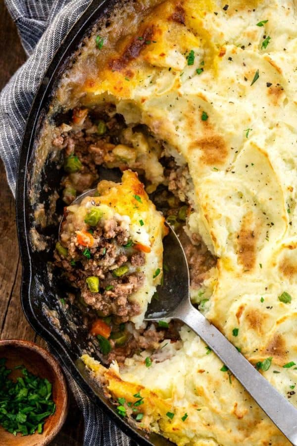 shepherds pie with a spoon full being scooped up