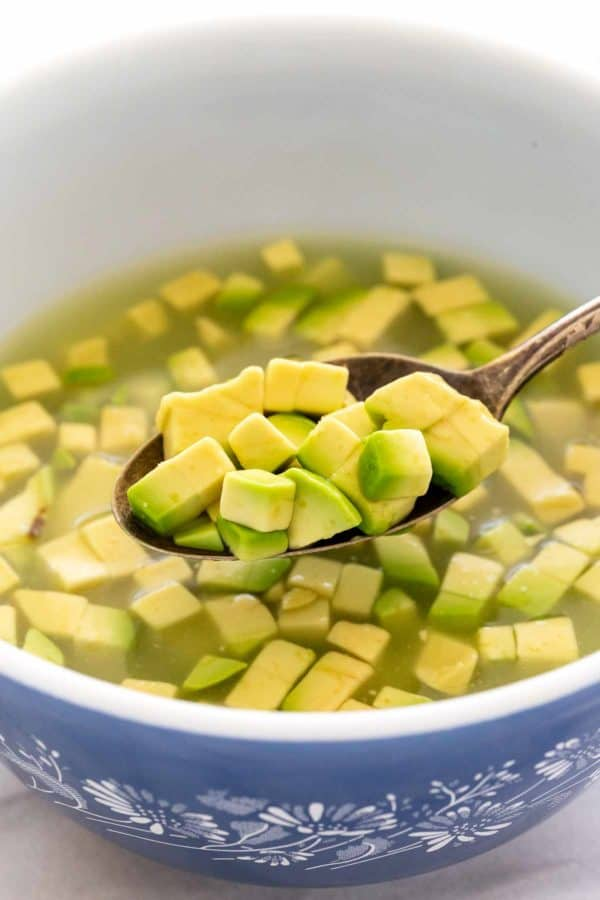 cubes of avocado in a bowl of water