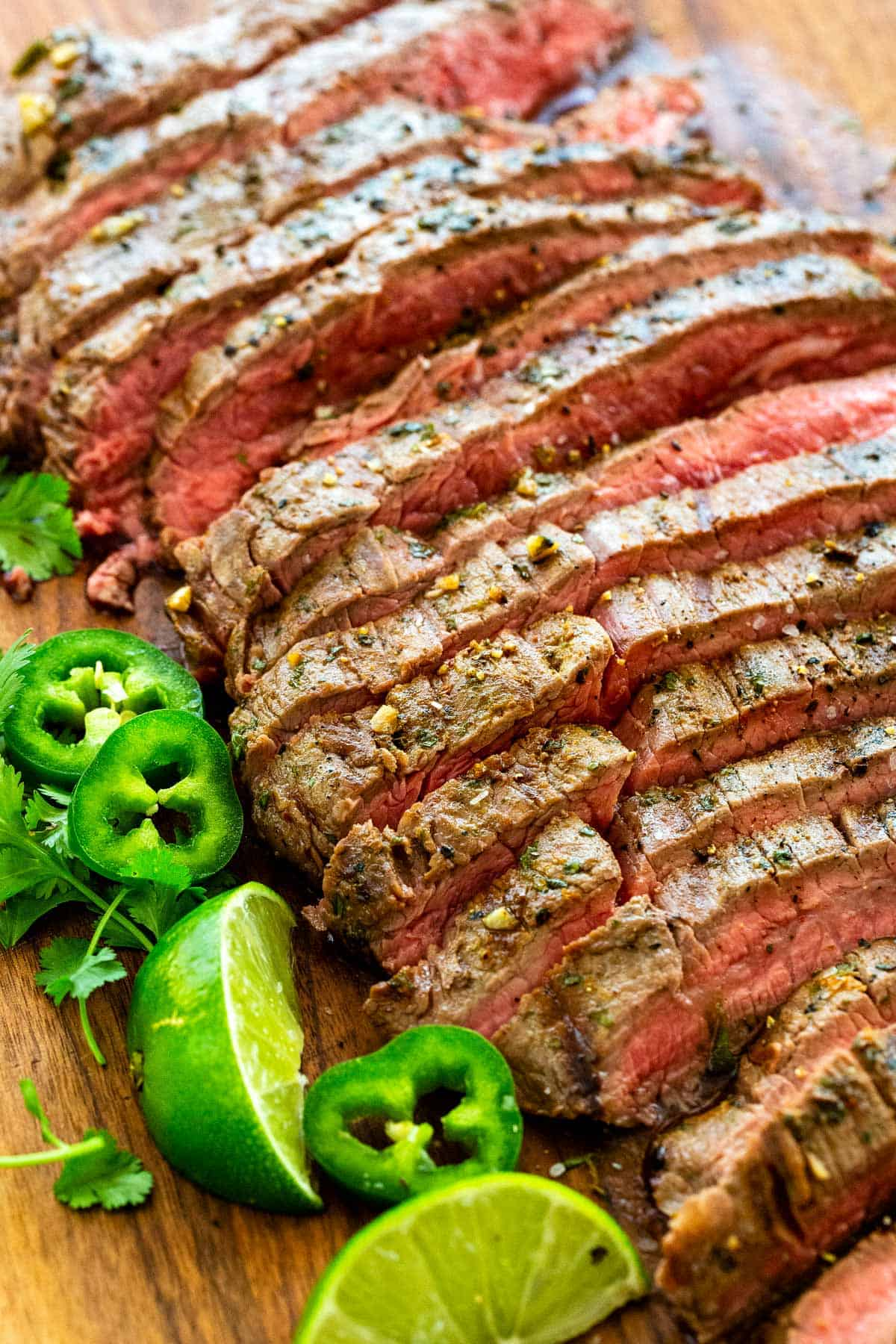 Carne asada recipe with a special marinade of citrus juices, garlic, jalapeno, cumin, and chili powder. Chop it up for tacos, or add it to a salad! #carneasada #steak #mexican #steaktacos
