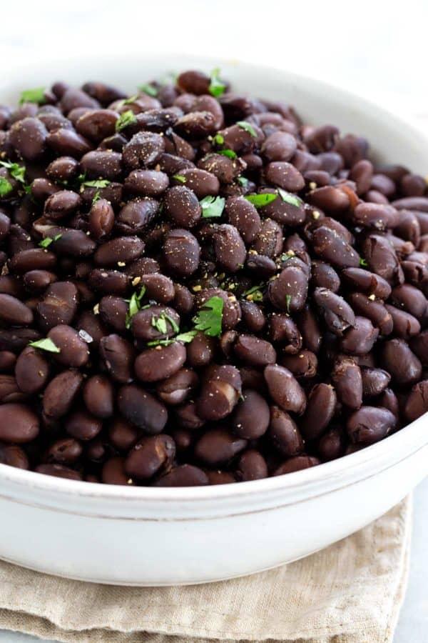 Black beans in a white bowl