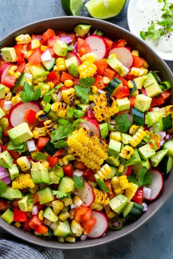 colorful corn salad with diced tomatoes and avocado