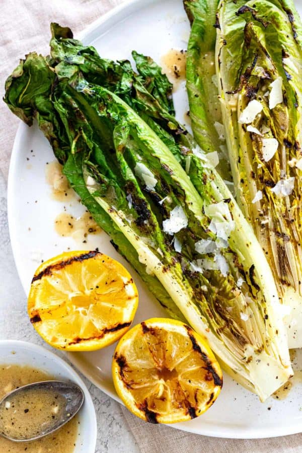 grilled romaine on a plate with lemon