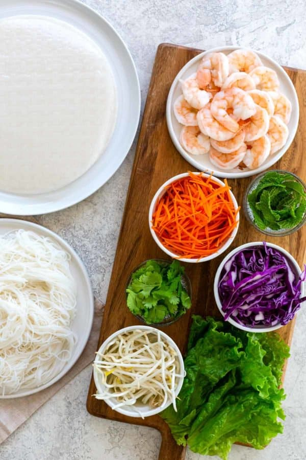spring roll ingredients laid out on a table