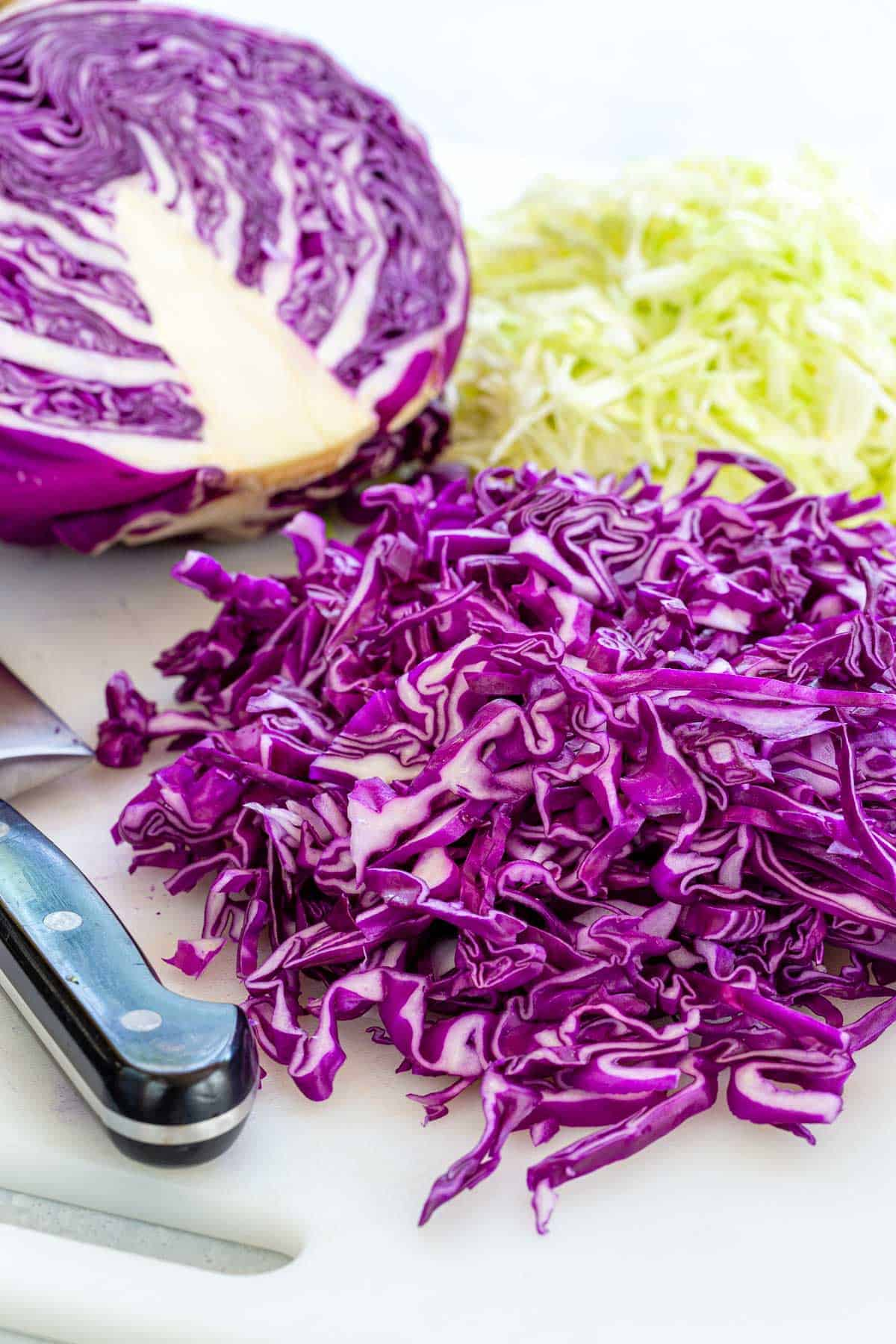 Learn how to cut cabbage with this easy step-by-step guide. This cruciferous vegetable can be used for salads, stir-fries, sauteed, boiled and braises. #cabbage #howtocook #cooking101
