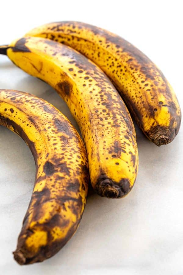 three ripen bananas with brown spots