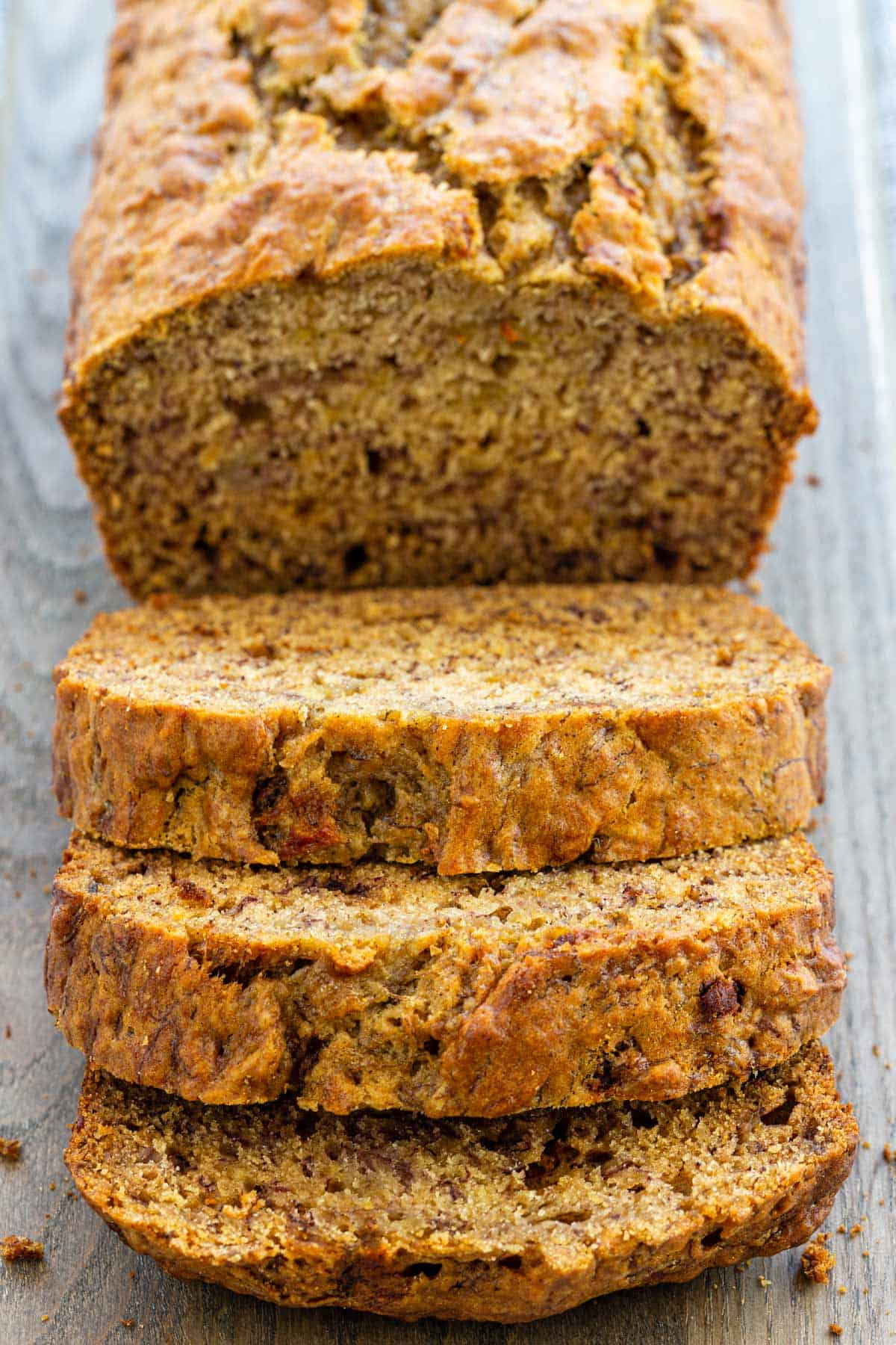 This banana bread takes the classic recipe to the next level by cooking ripe bananas, extracting the juice, and reducing it for caramelized flavor. #bananabread #bread #loaf #banana