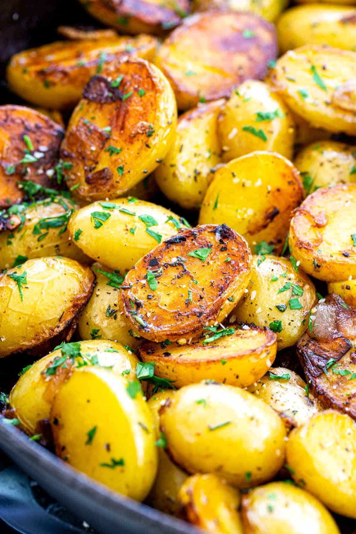 Easy skillet potatoes seasoned with herbs and garlic for a delicious one-pan side dish. Creamy Yukon Gold potatoes are used for better texture and flavor. #skilletpotatoes #sidedish #potatoes