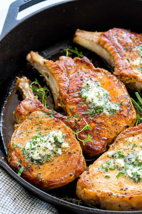 pan seared pork chops topped with compound butter