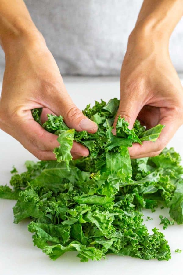 massaging kale leaves