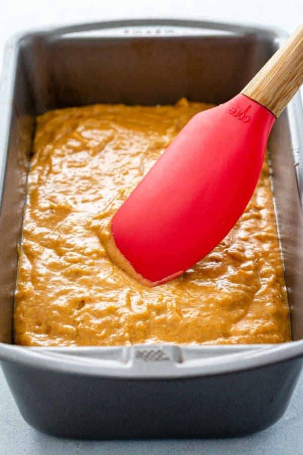 pumpkin batter in a bread loaf pan