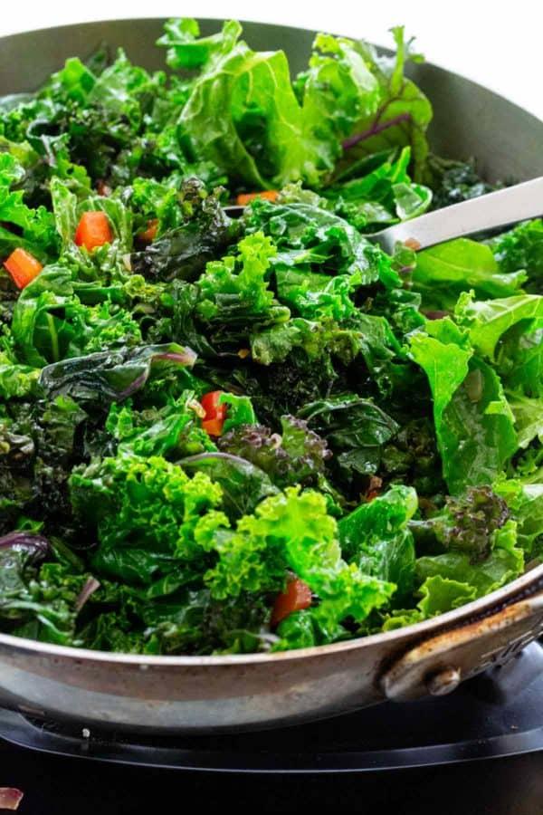 sauteing kale in a pan