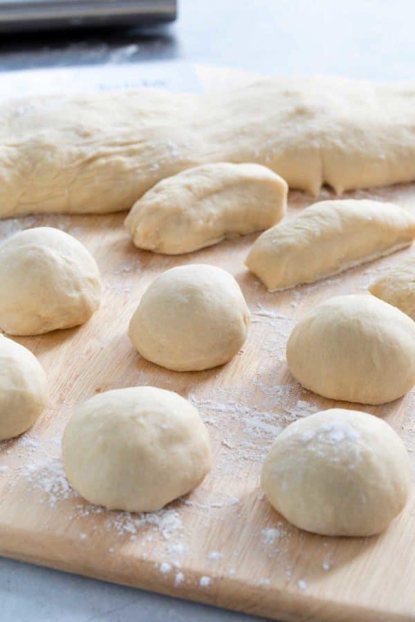 dough balls on a floured cutting board