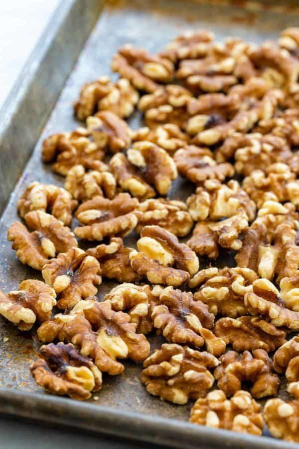 roasted walnuts on a baking sheet pan