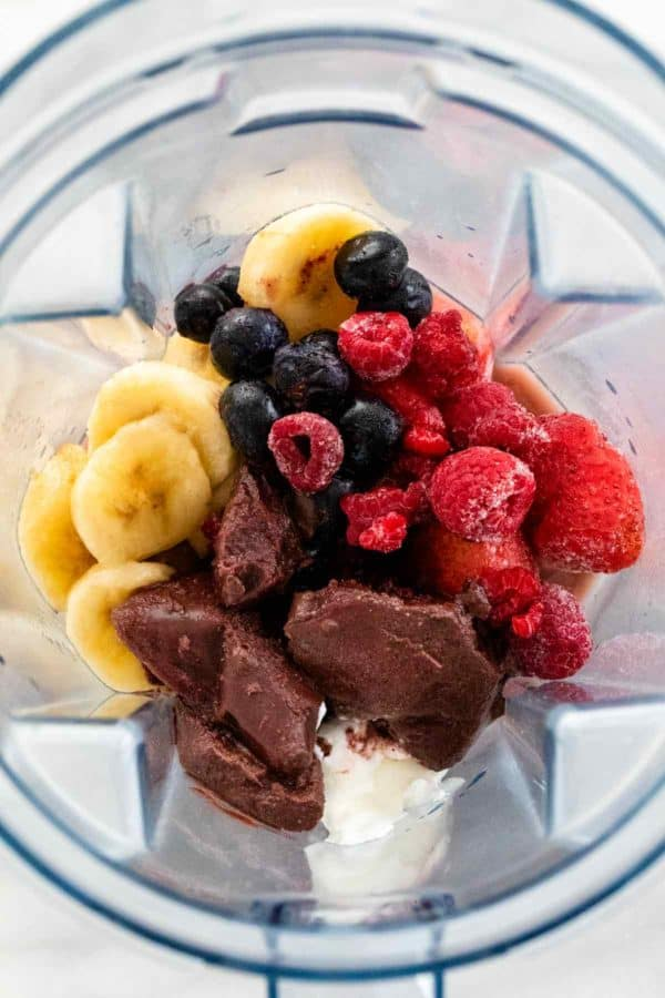 Frozen acai and fruit in a blender cup