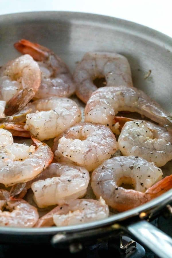 shrimp cooking in a saute pan