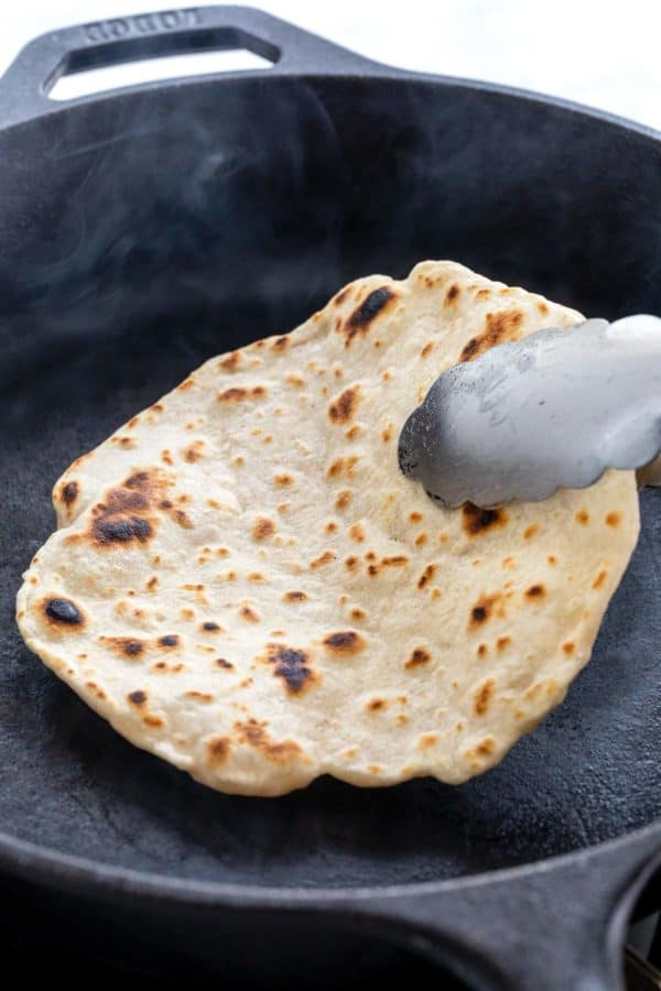 Cooking a flour tortilla in a cast iron skillet