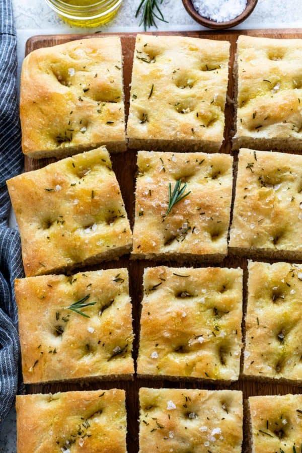 Focaccia bread cut into multiple square pieces