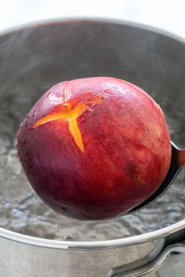Removing a peach from boiling water