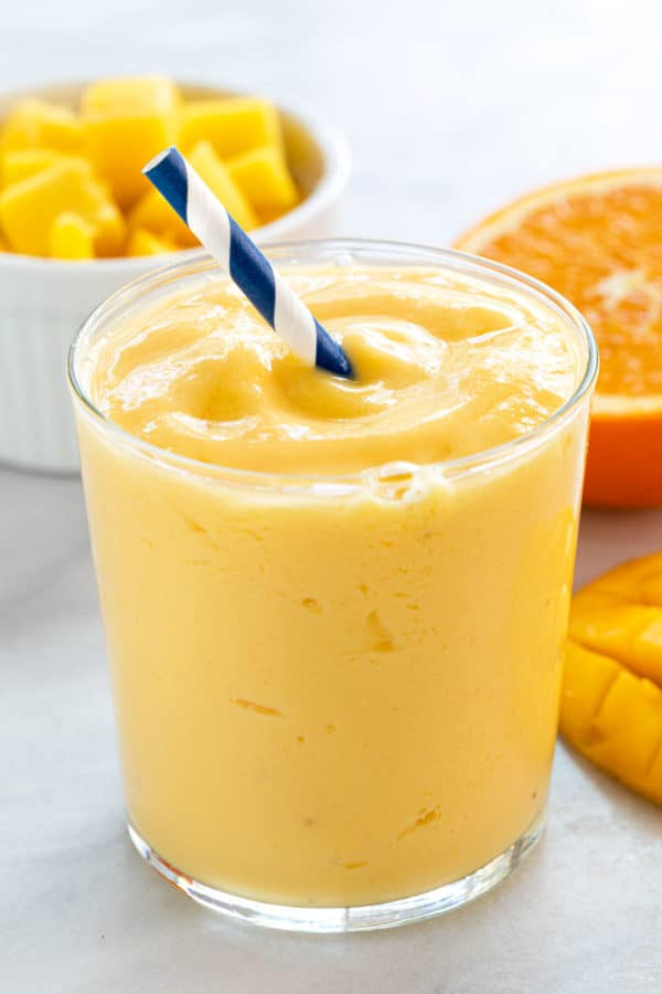 Glass filled with mango smoothie