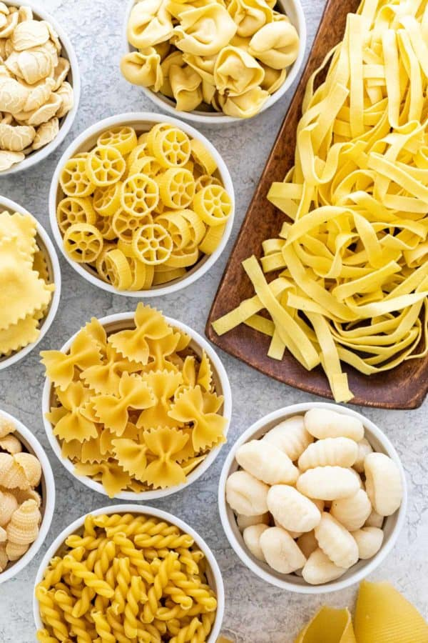Several types of pasta laid out on a table