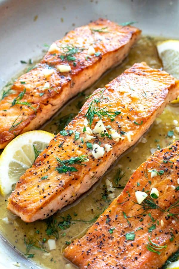 Three fillets of pan seared salmon with lemon garlic sauce
