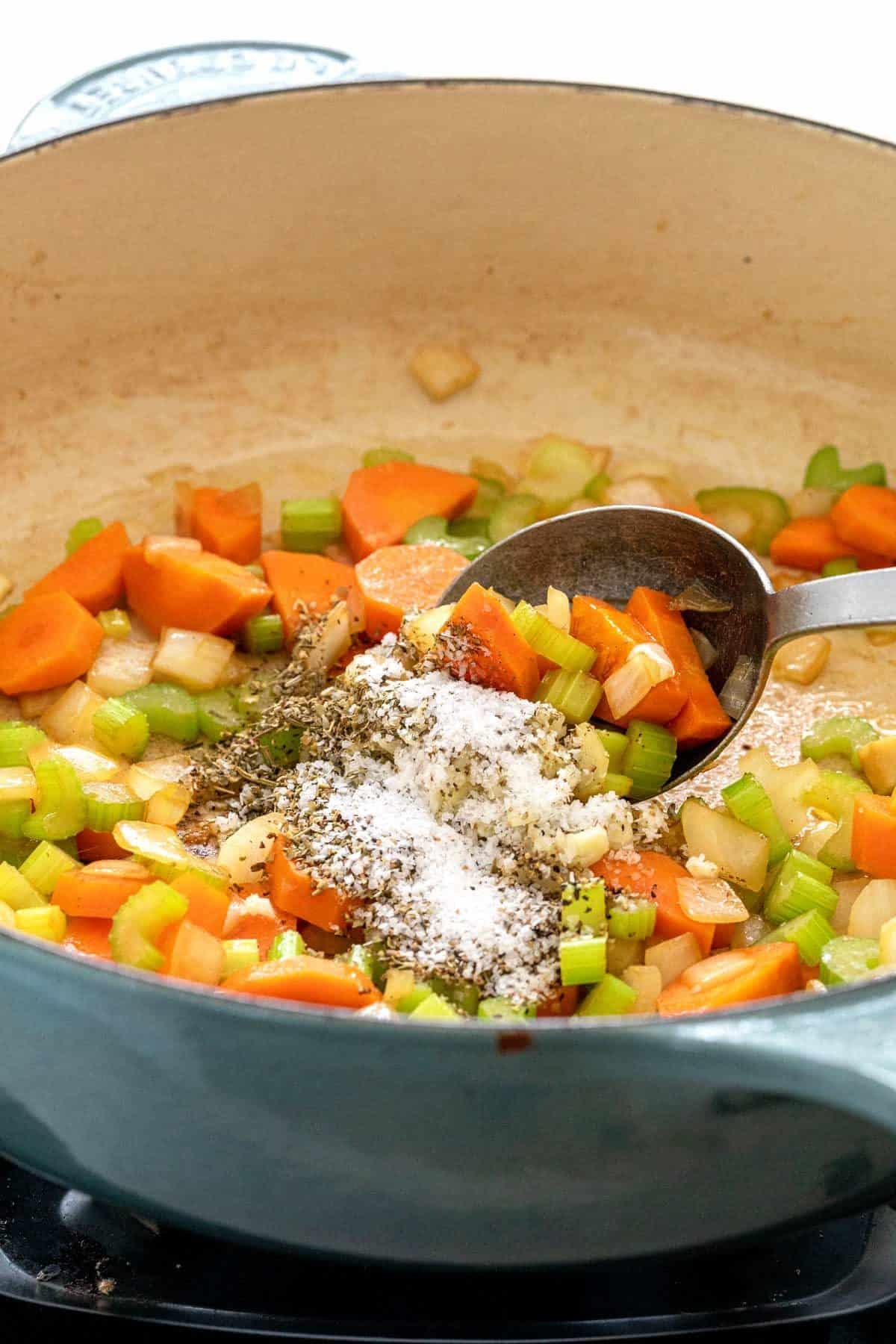 Chopped vegetables and seasonings in a pan