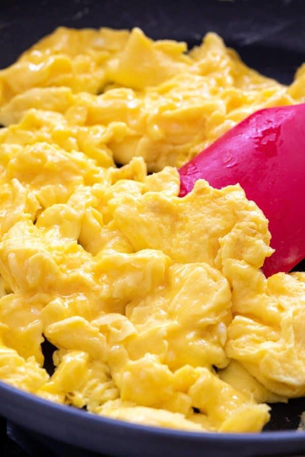 fluffy scrambled eggs in a pan