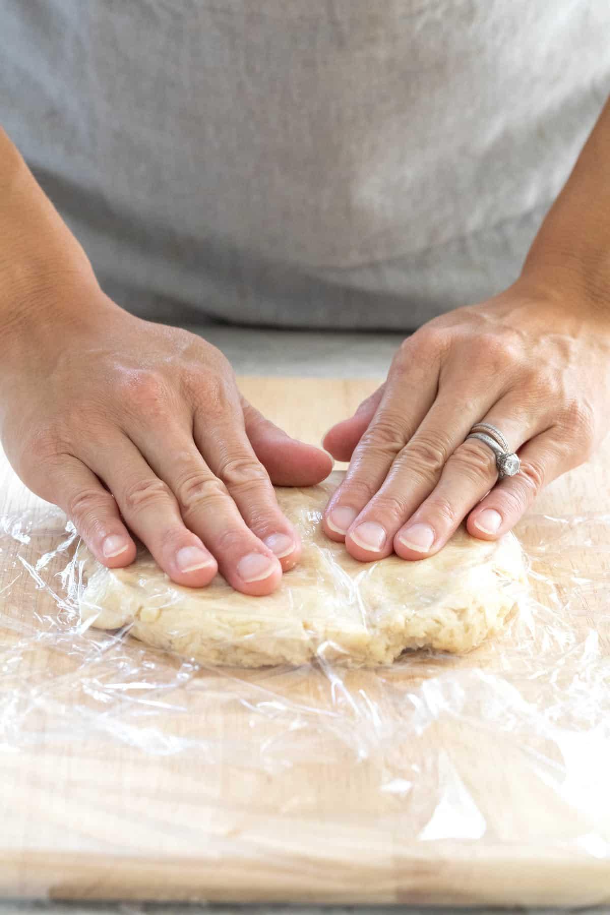 Flattening dough on a wooden board