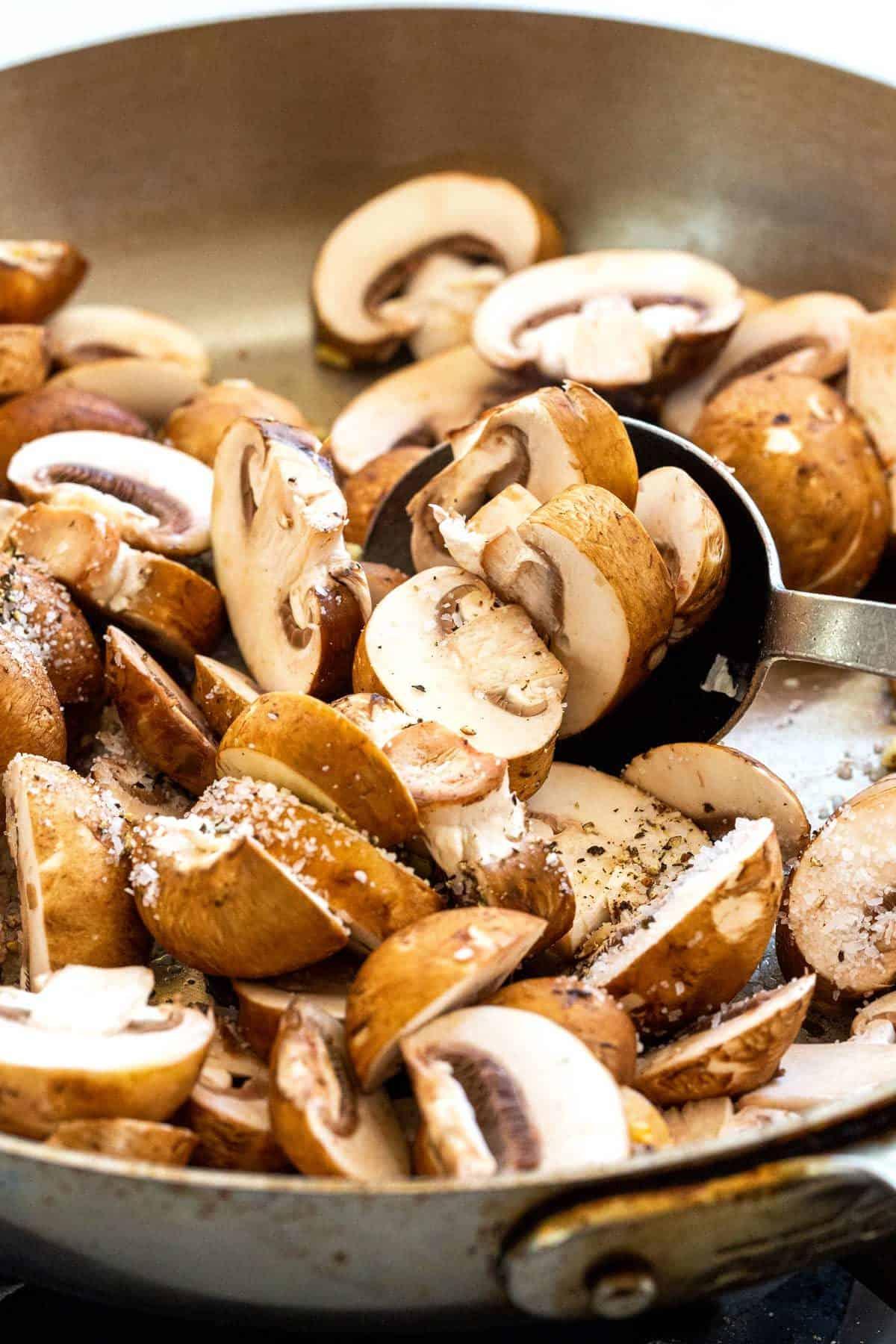 Sliced brown mushrooms in a pan