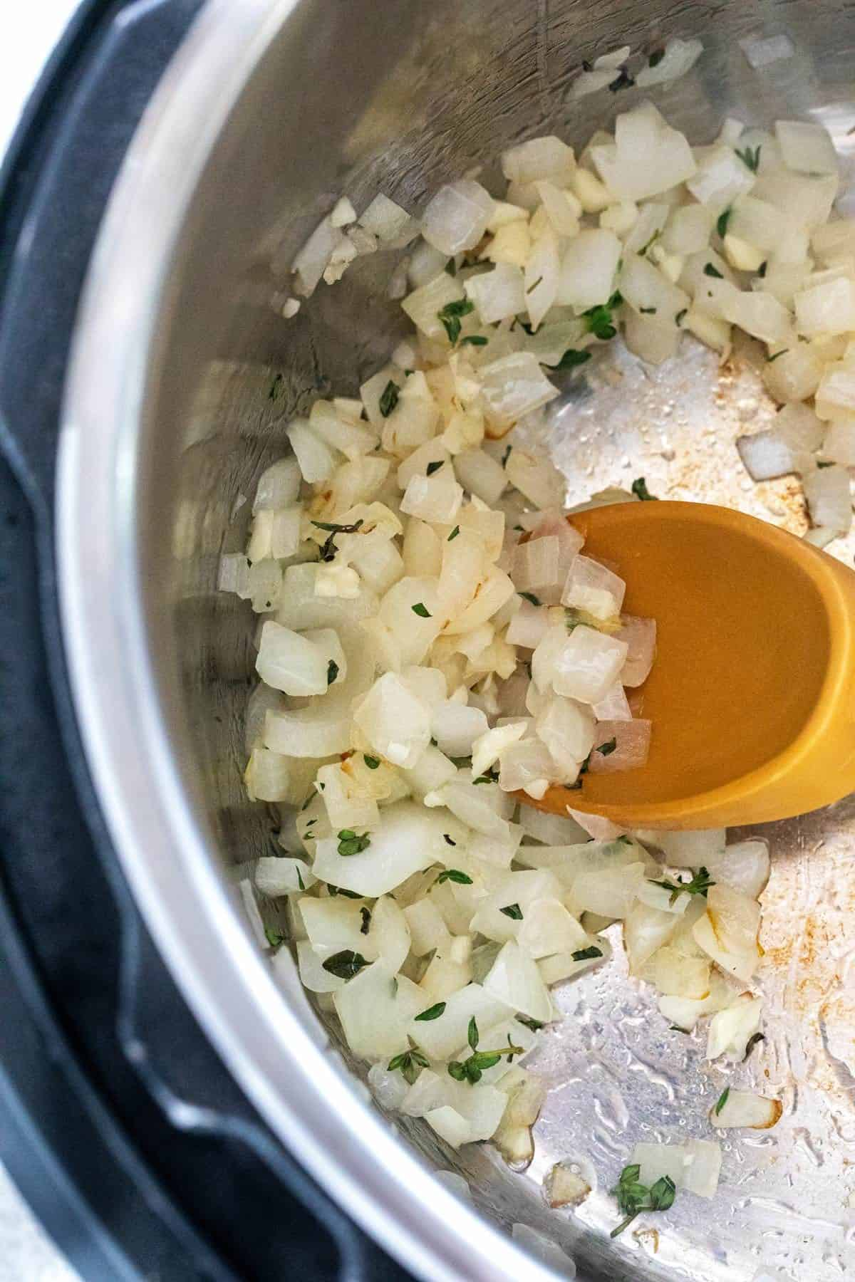 Sauteing diced onions in a pot