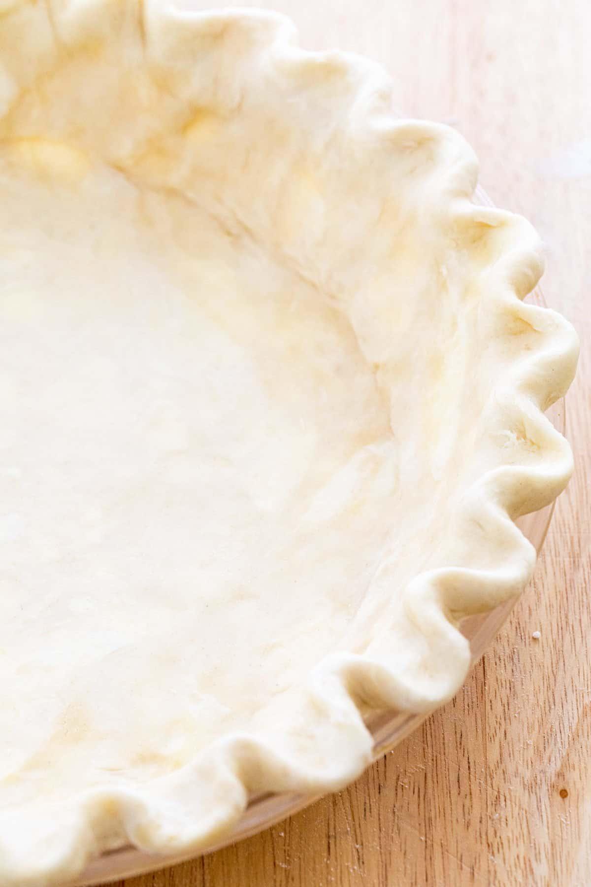 Raw dough in a pie plate