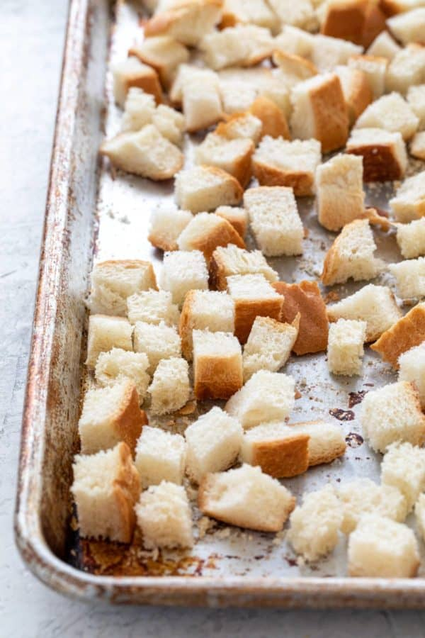 cubes of bread on a sheet pan