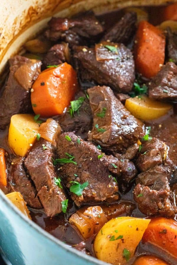 Close up of beef stew cooking in a dutch oven