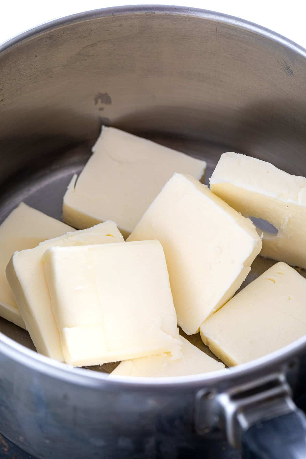 several slices of butter in a small saucepan