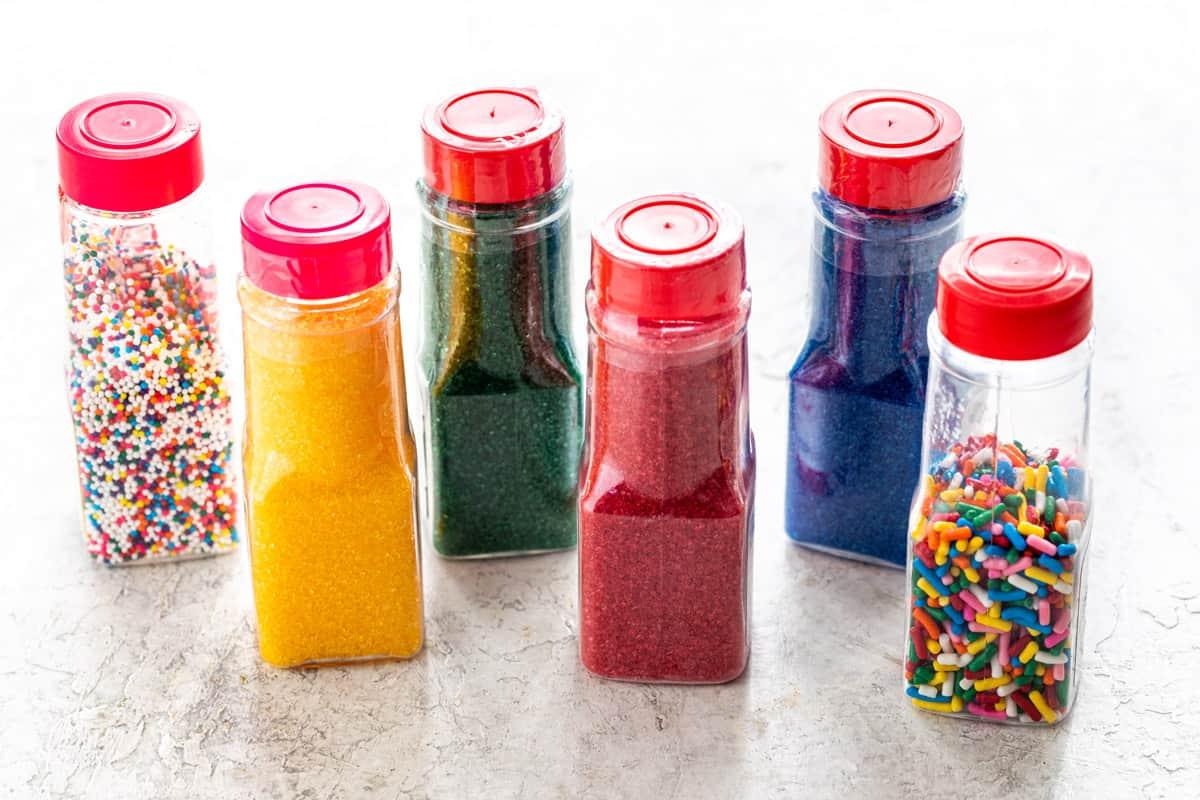 Several small bottles of sprinkles