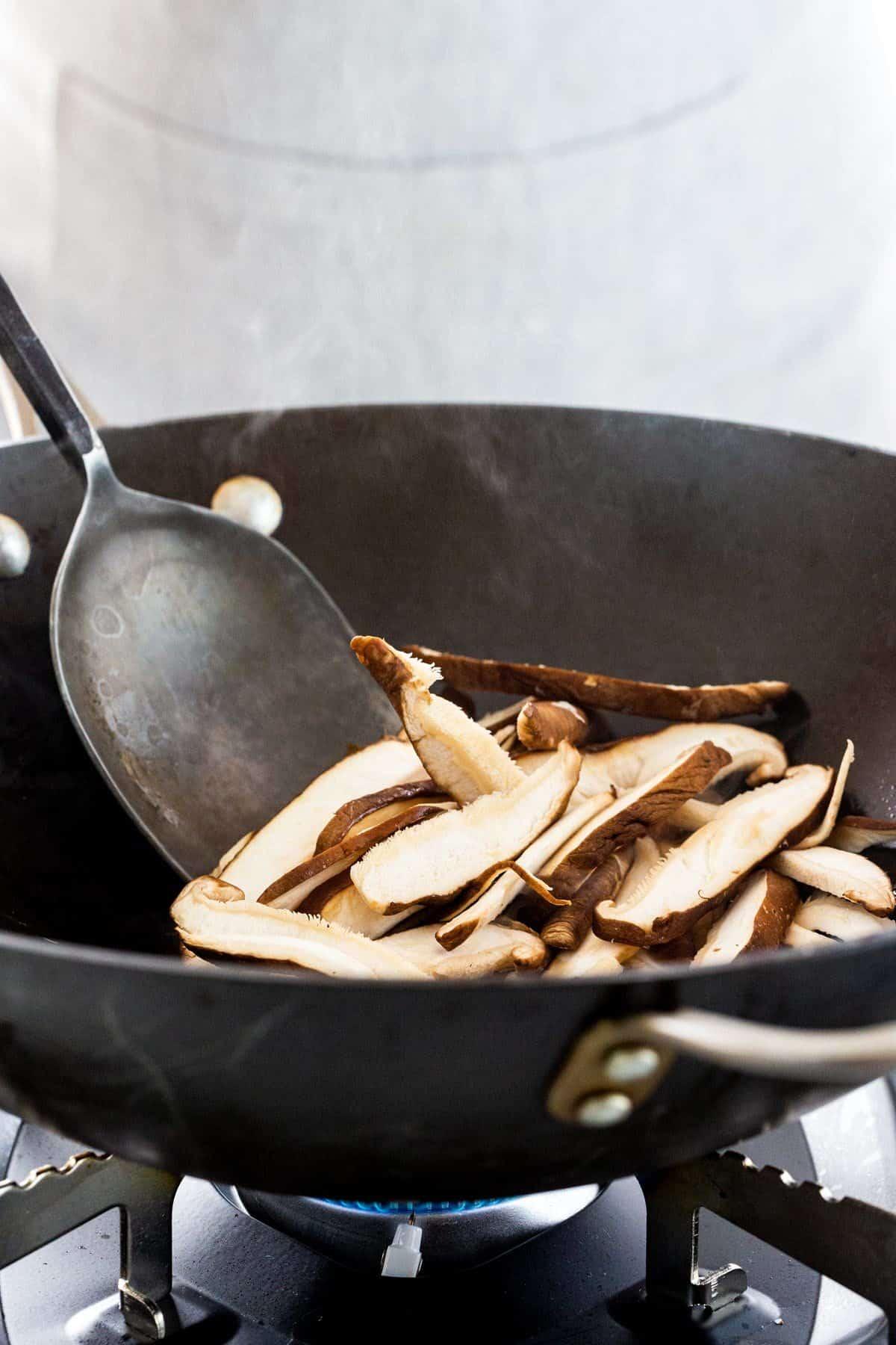 cooking mushrooms in a wok