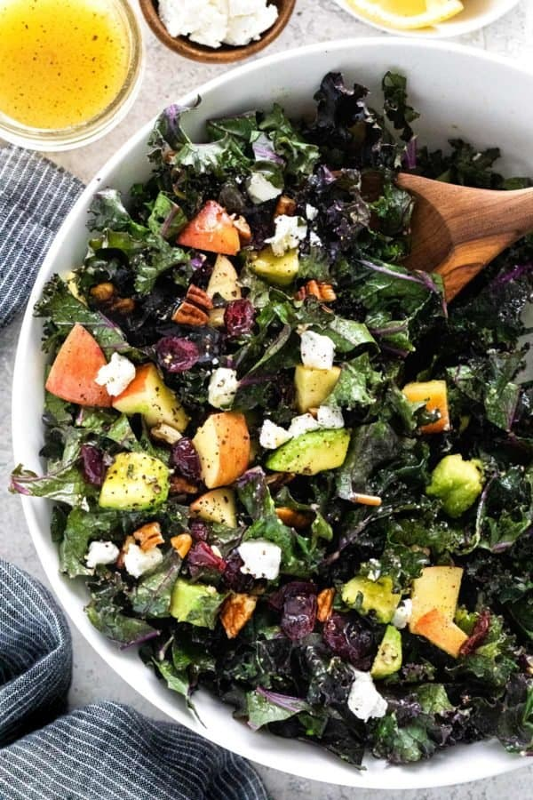 bowl of kale salad with apples and avocados
