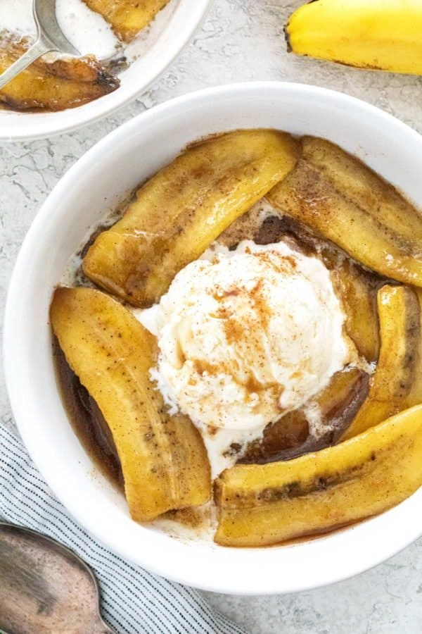 top down photo of a dessert with banana and ice cream