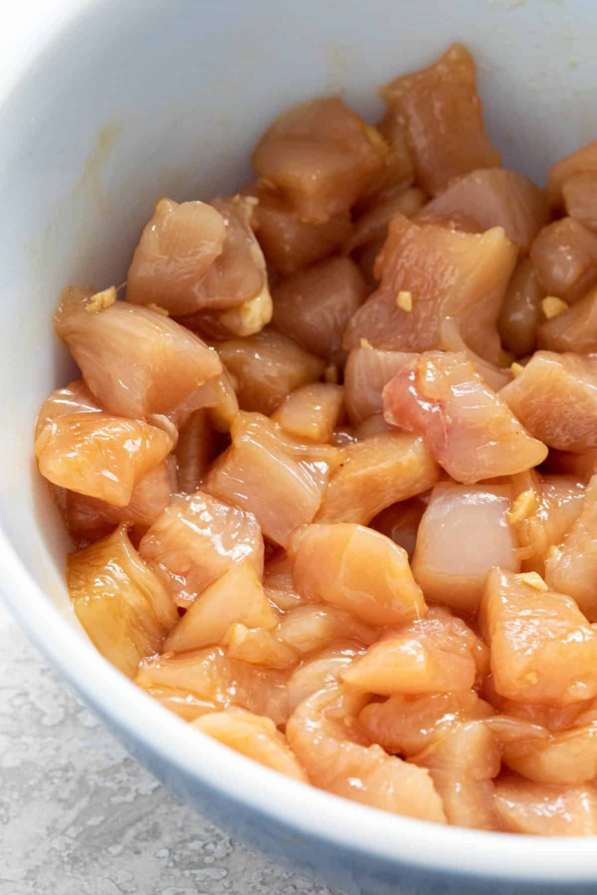 marinating chicken in a bowl