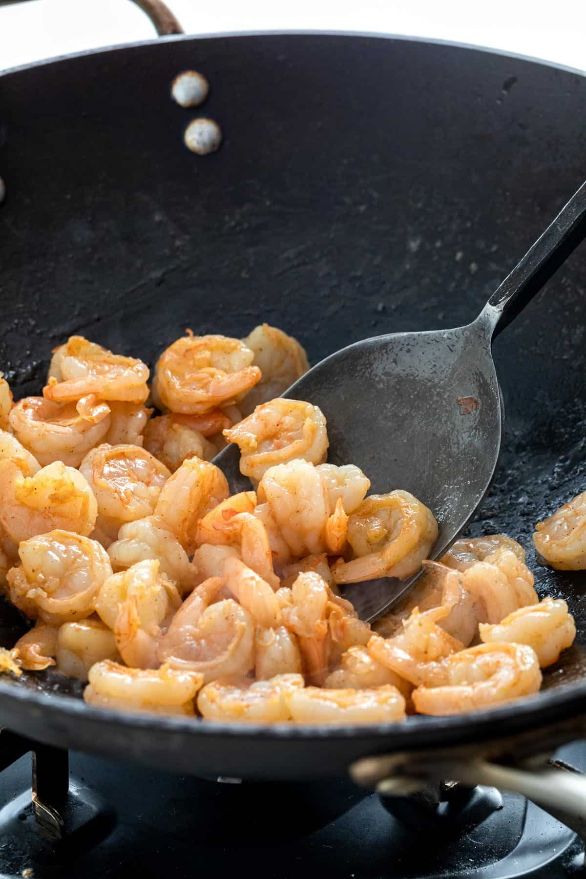 cooked pieces of shrimp in a pan