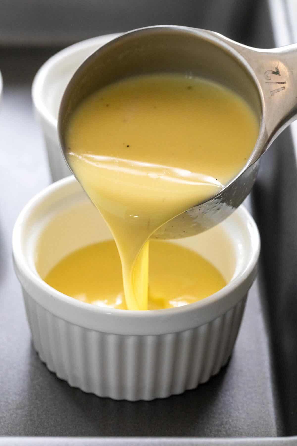 filling a ramekin with egg custard