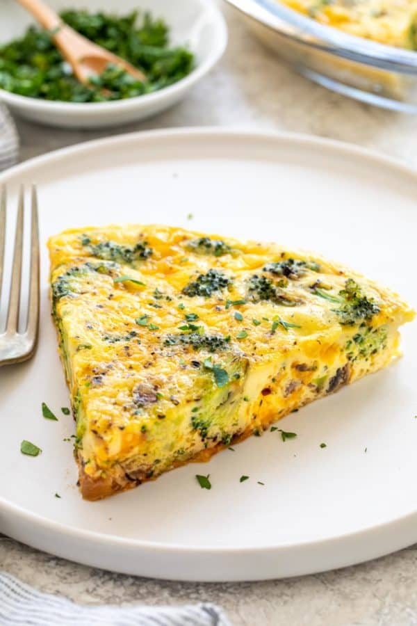 slice of crustless quiche on a white plate